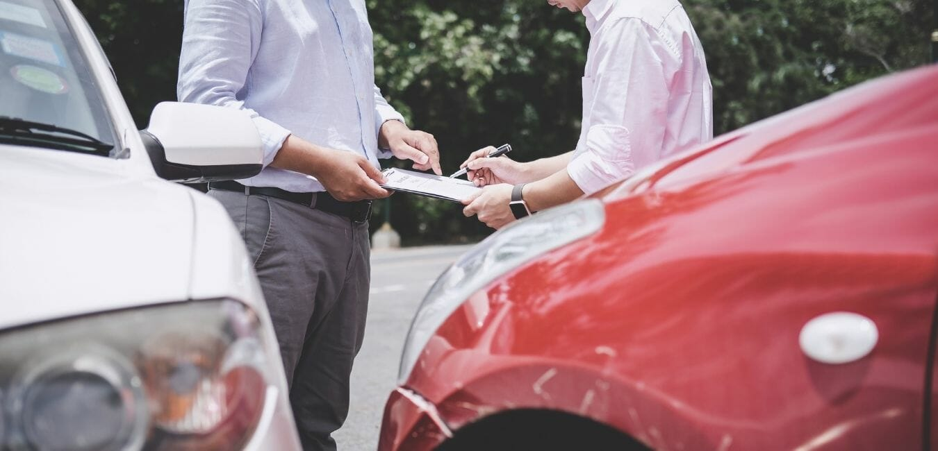 2 guys with red and white car