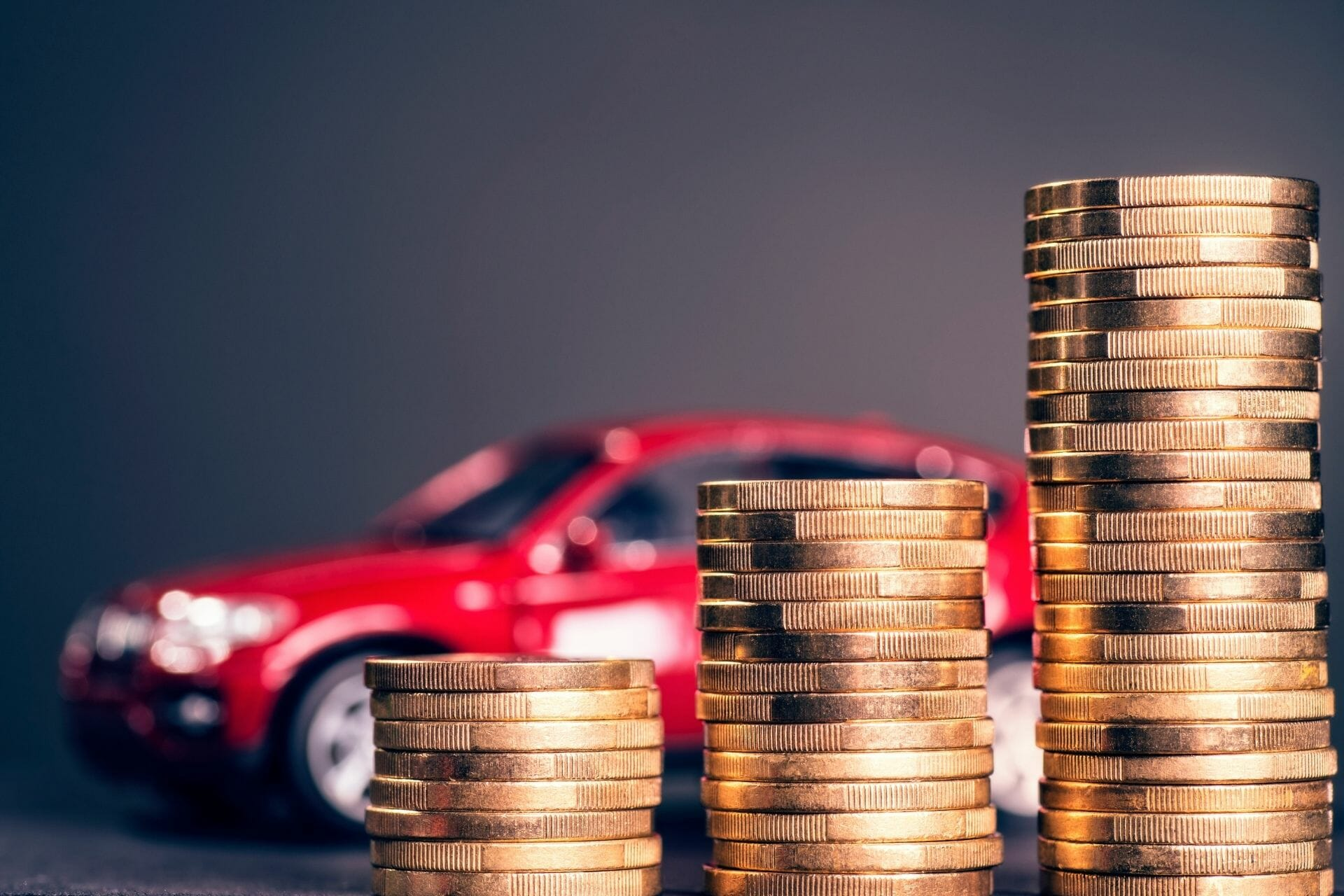 coins and red car
