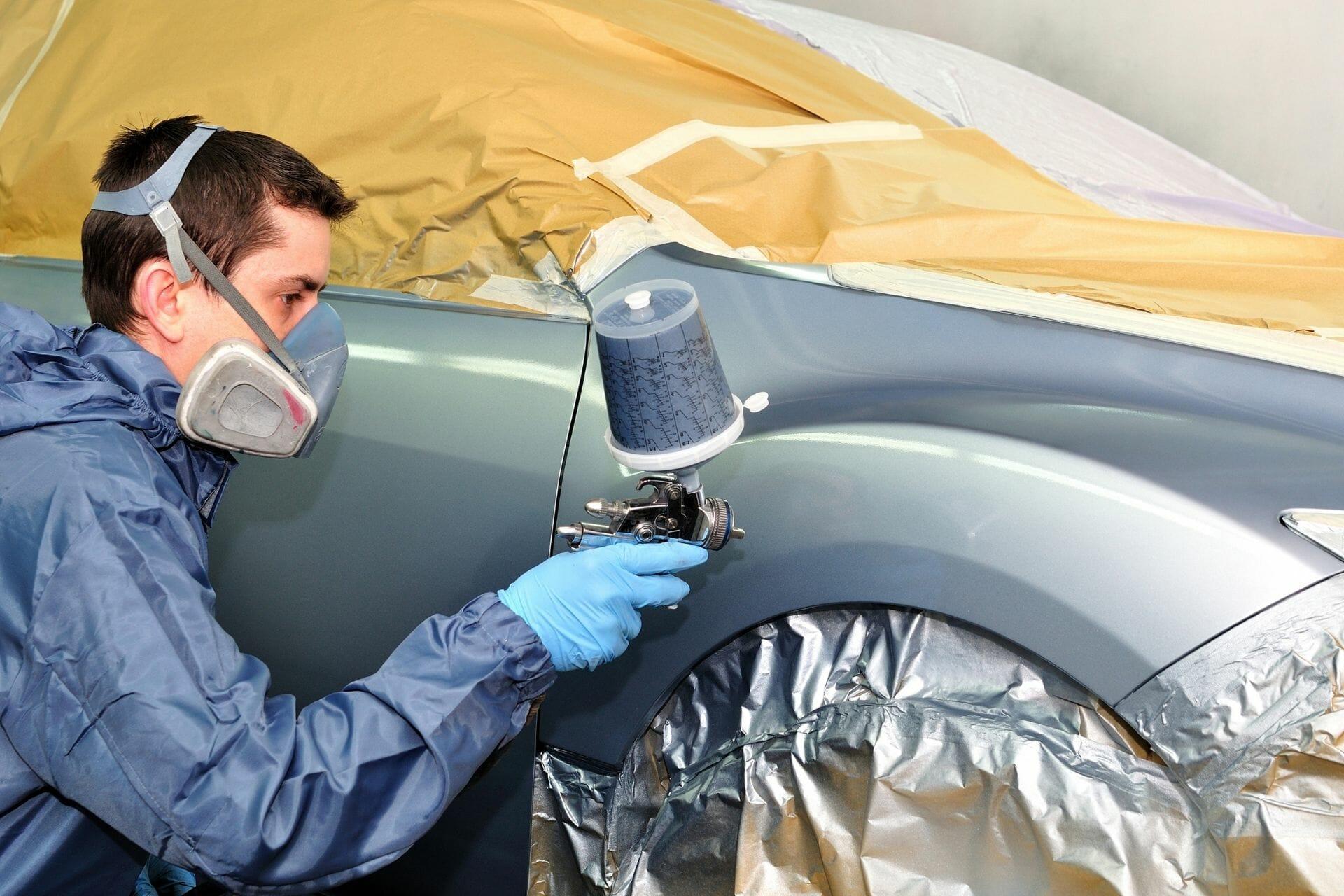 guy spraying car paint