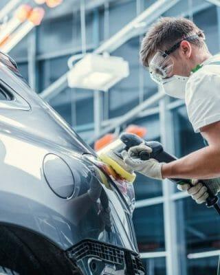guy polishing car