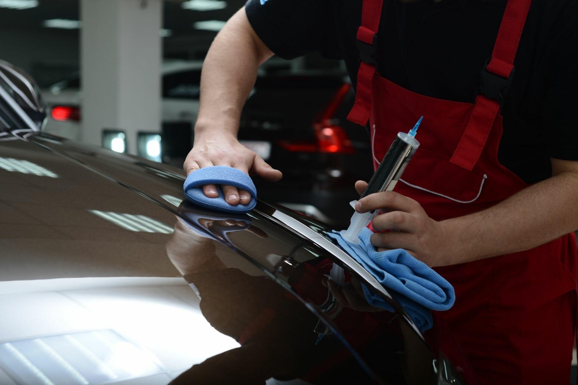 technician polishing car
